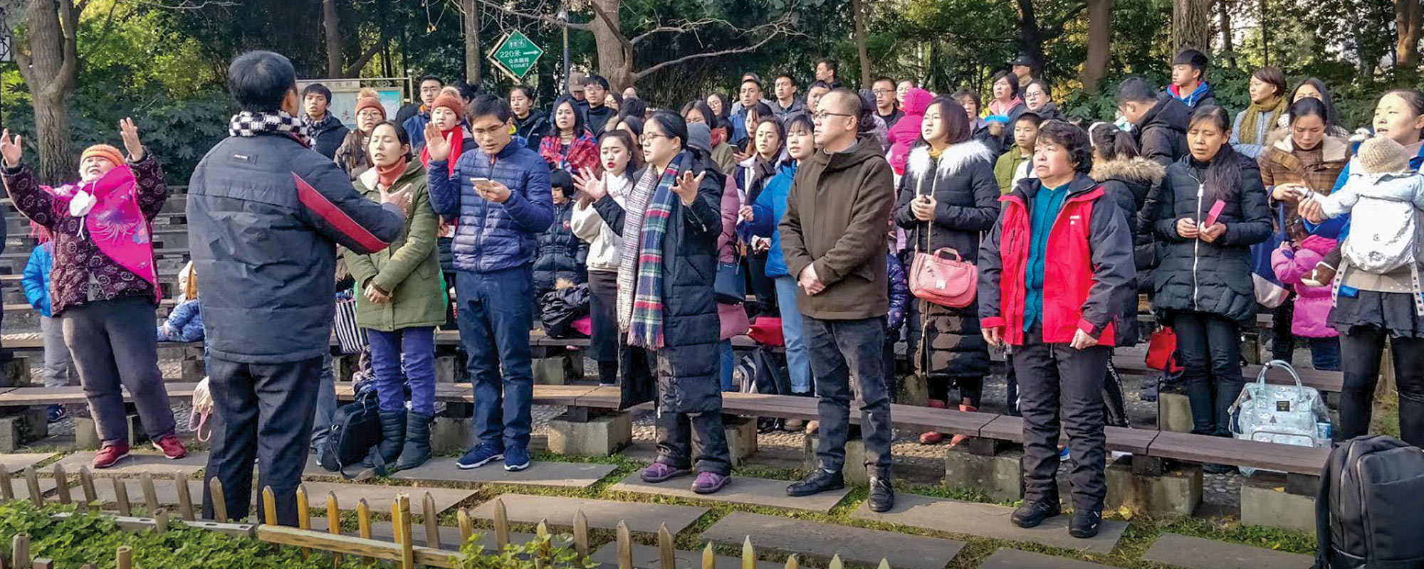 Group of people in Chinese park praying