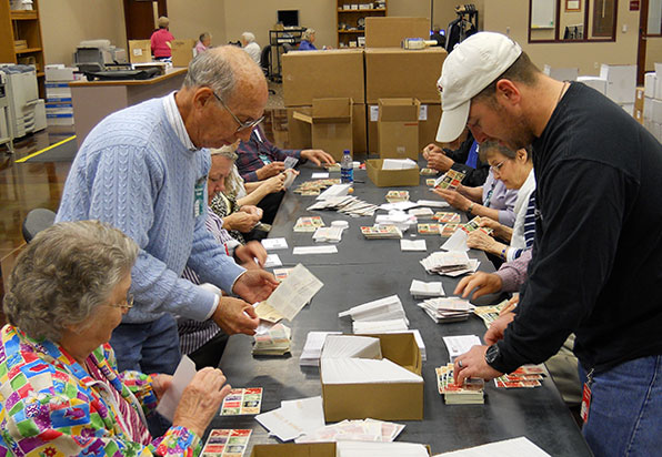Volunteers filling boxes