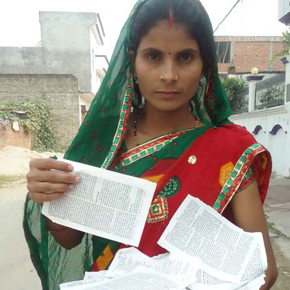 Poonam holding a torn bible