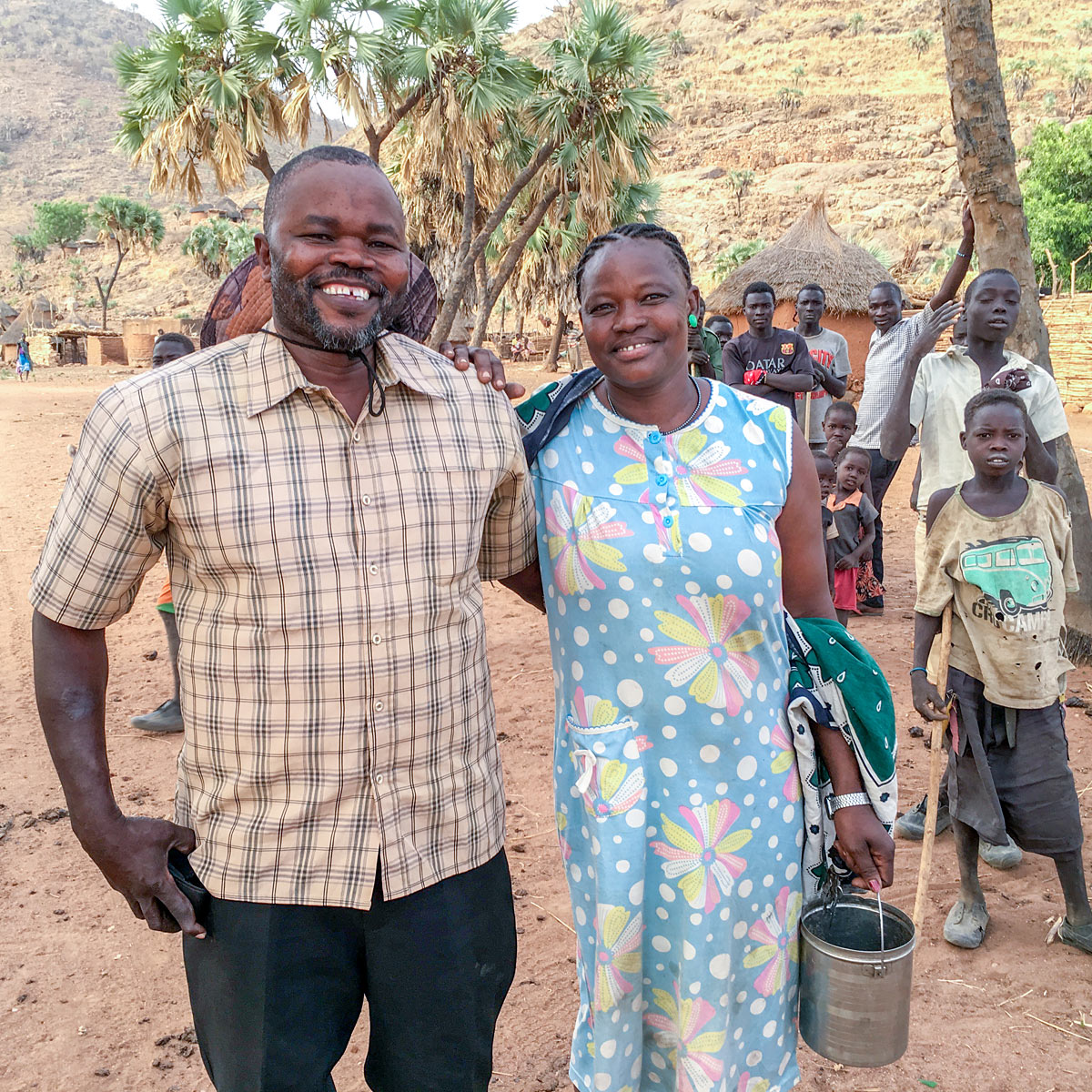 Morris and his wife in African village